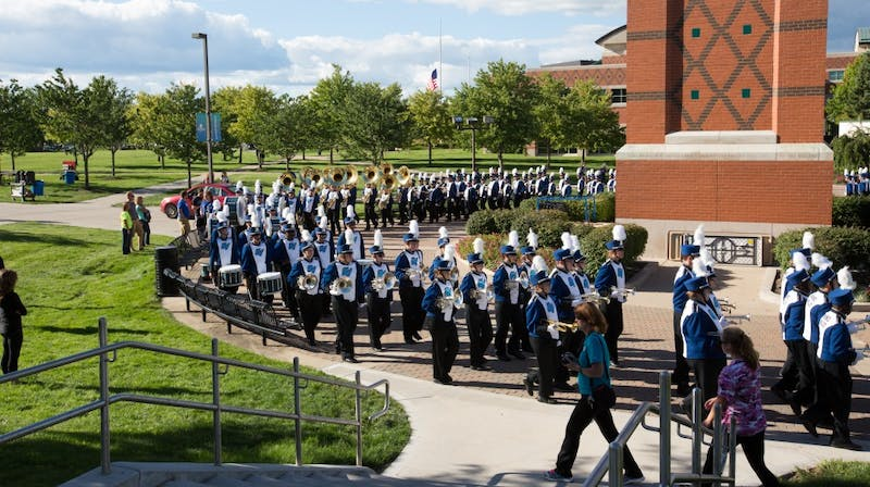 GVL/Kevin Sielaff - The GVSU marching band marches around the clock tower before kick-off. Grand Valley defeats Tiffin with a final score of 45-7 on Thursday, September 1, 2016 at Lubbers Stadium.