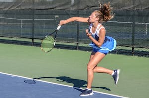 Senior Lexi Rice forehands the ball during Saturday morning's match against Wayne State University; Rice was playing doubles with her partner Carola Orna (junior). GVL / Hannah Mico.