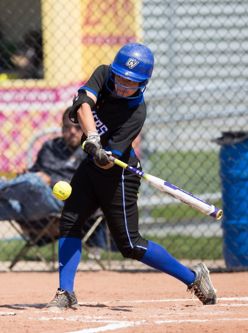 GVL / Kevin Sielaff – Teagan Shomin (9) takes a swing at an incoming pitch. Grand Valley takes the victory over Walsh in both games held in Allendale on Saturday, April 23, 2016.