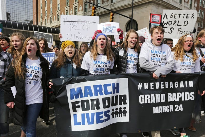 GVL / Emily Frye  Student leaders from Forest Hills Northern High School direct the 'March for Our Lives' protest in Grand Rapids, Michigan, on Saturday, March 24.
