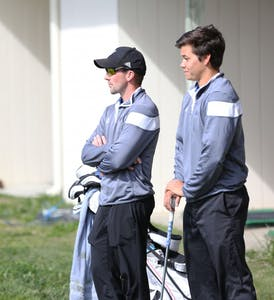 GVL / Kevin Sielaff - Head coach Gary Bissell instructs Domenic Mancinelli April 29 at the Meadows Golf Course in Allendale.