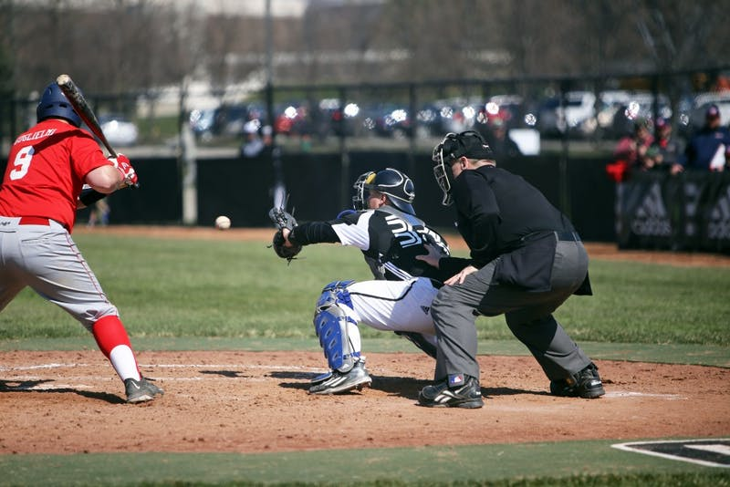 GVL / Emily Frye   Catcher Brody Andrews makes the catch at home against Saginaw Valley State University on Saturday Mar. 26, 2016.