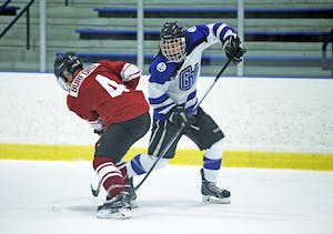 GVL / Emily FryeCameron Dyde keeps a hold of the puck to drop on Friday Oct. 7, 2016 against Rochester College.