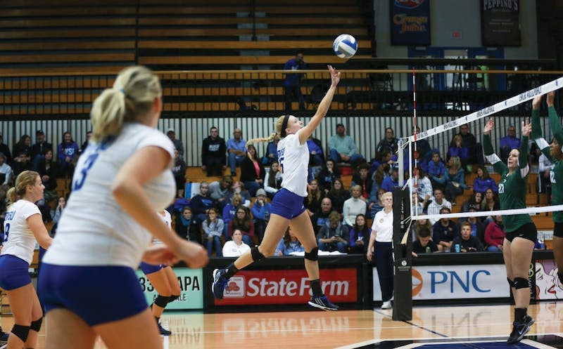 GVL / Kevin Sielaff - Kaleigh Lound (15) tips the ball high over the net. Grand Valley sweeps Tiffin Oct. 3 after three sets inside the Fieldhouse Arena in Allendale.