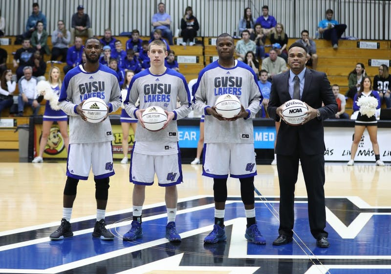 GVL/Kevin Sielaff - Seniors from the men's basketball team are celebrated after the game against Northern Michigan on Saturday, Feb. 18, 2017 inside the Fieldhouse Arena in Allendale.