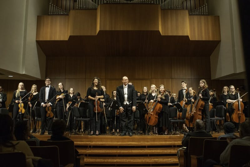 Grand Valley's Orchestra performing February 19 in the Cook-DeWitt Center under the direction of Henry Duitman.  GVL / Andrew Nyhof