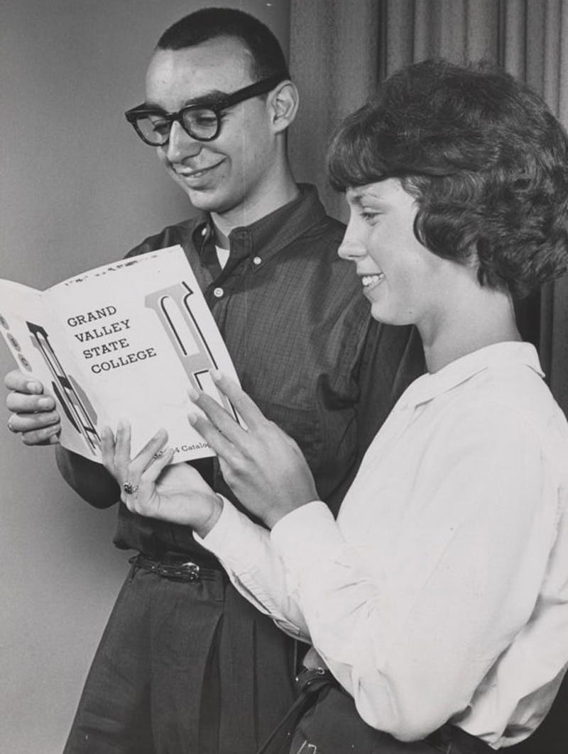 Courtesy Photo / gvsu.eduStudents look at the first Grand Valley catalog