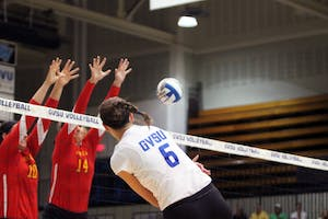 Senior Betsy Ronda (#6) puts down a kill against Ferris State in a 2014 matchup. Ronda picked up her 1,000th career kill over the weekend in the GVSU Laker Riverfront Classic.