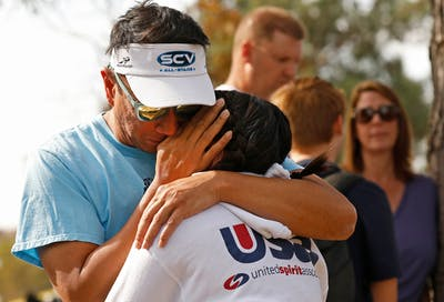 Saugus High School 10th grader Ella Cabigting is hugged by her father, Emerson, Nov. 14 as they are reunited in Central Park after being evacuated from Saugus High School. A gunman opened fire in the high school in Santa Clarita, California.