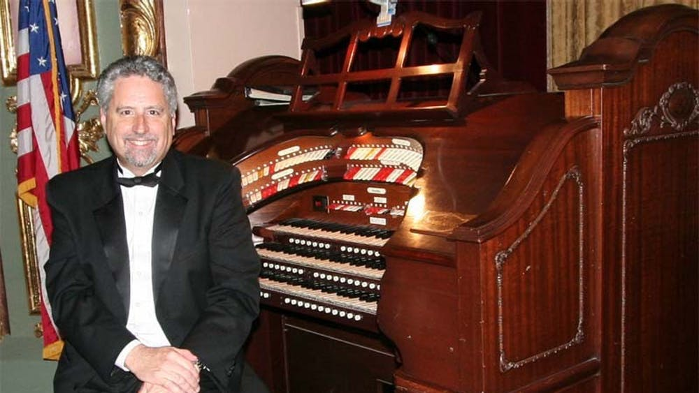 Dennis James at the keyboard of the Mighty Wurlitzer at the Coleman Theater in Miami, Oklahoma, in September 2007. James will be returning to the IU Auditorium to perform this month.