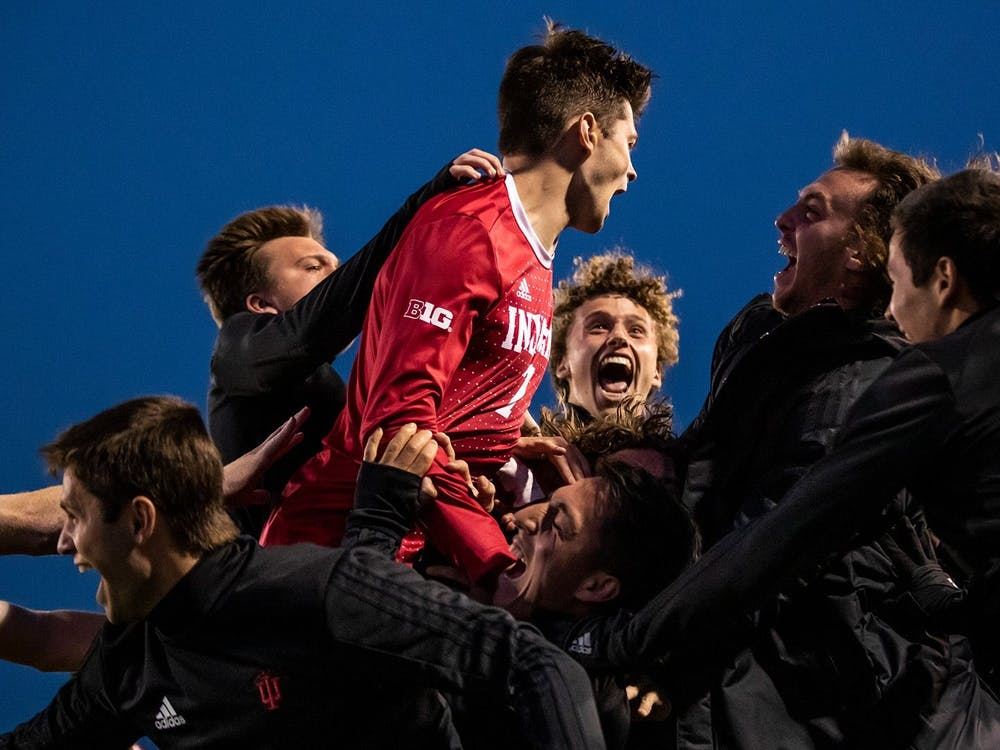 The IU men's soccer team celebrates after a 2-0 win over Maryland on April 14 at Bill Armstrong Stadium. IU defeated Seton Hall University 2-0 on Monday to advance to the College Cup.