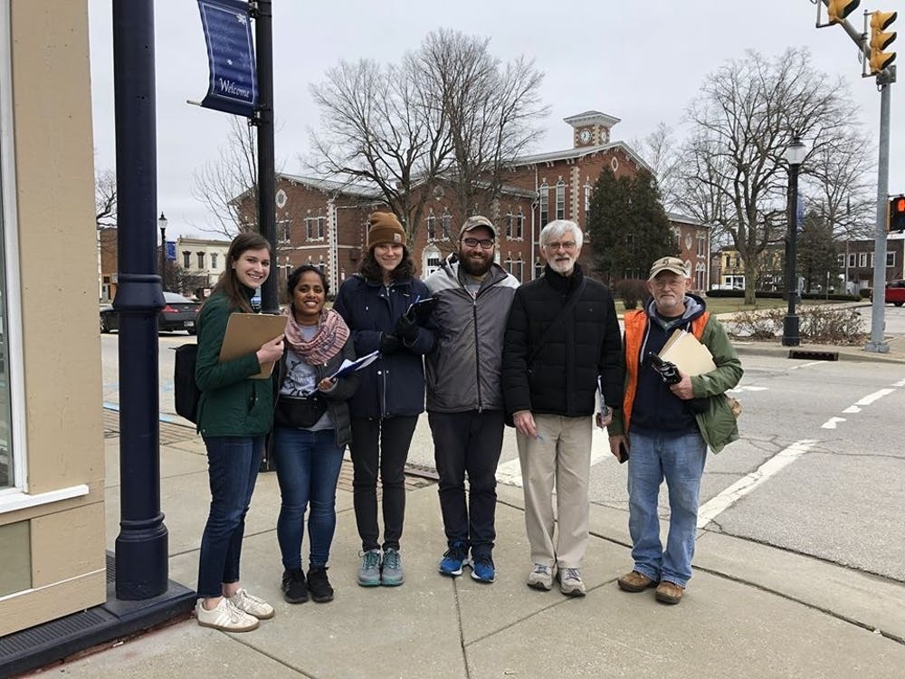 Members of Hoosier Action go door-to-door telling people about the changes to the Healthy Indiana Plan in Martinsville, Indiana. Hoosier Action is an organization that is fighting against the new work reporting requirement that some HIP recipients are going to have to start doing.