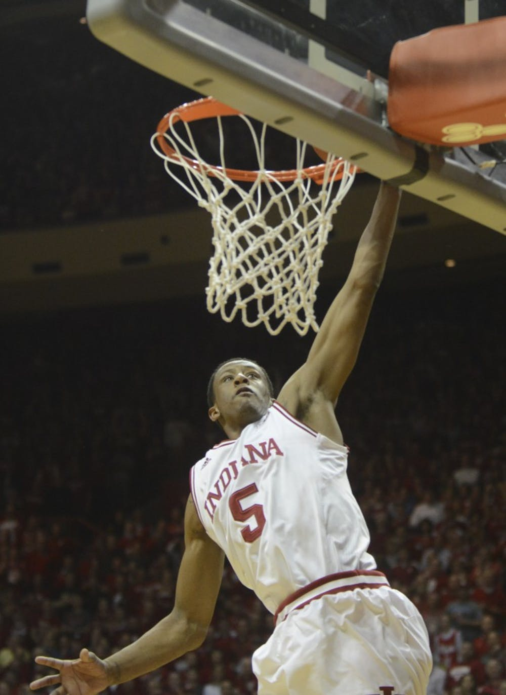 Junior forward Troy Williams dunks during the game against Purdue on Saturday at Assembly Hall.