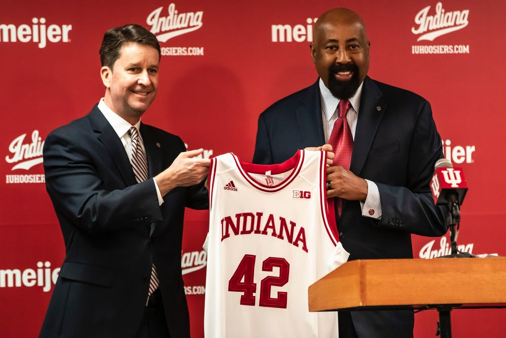 <p>Indiana men&#x27;s basketball head coach Mike Woodson Indiana University athletic director Scott Dolson hold a jersey during a press conference on March 29, 2021, in Bloomington. Indiana held its annual preseason media day Monday. </p>