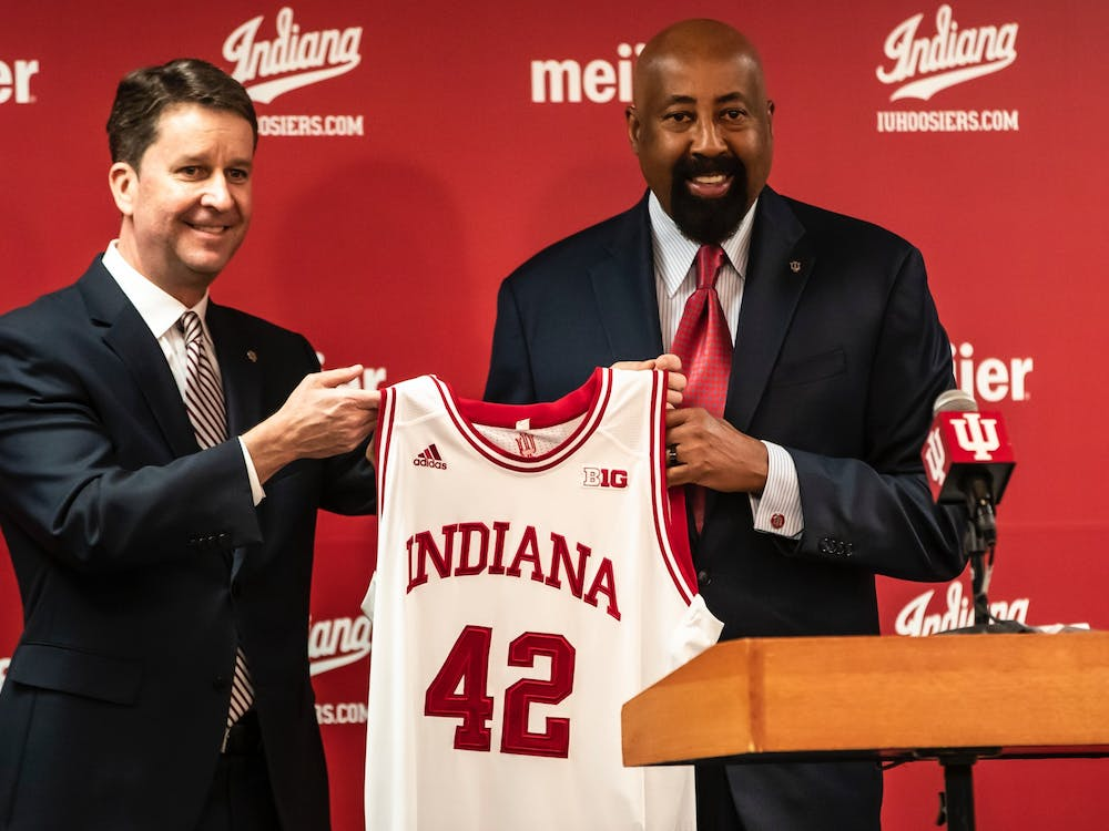Indiana men's basketball head coach Mike Woodson Indiana University athletic director Scott Dolson hold a jersey during a press conference on March 29, 2021, in Bloomington. Indiana held its annual preseason media day Monday.