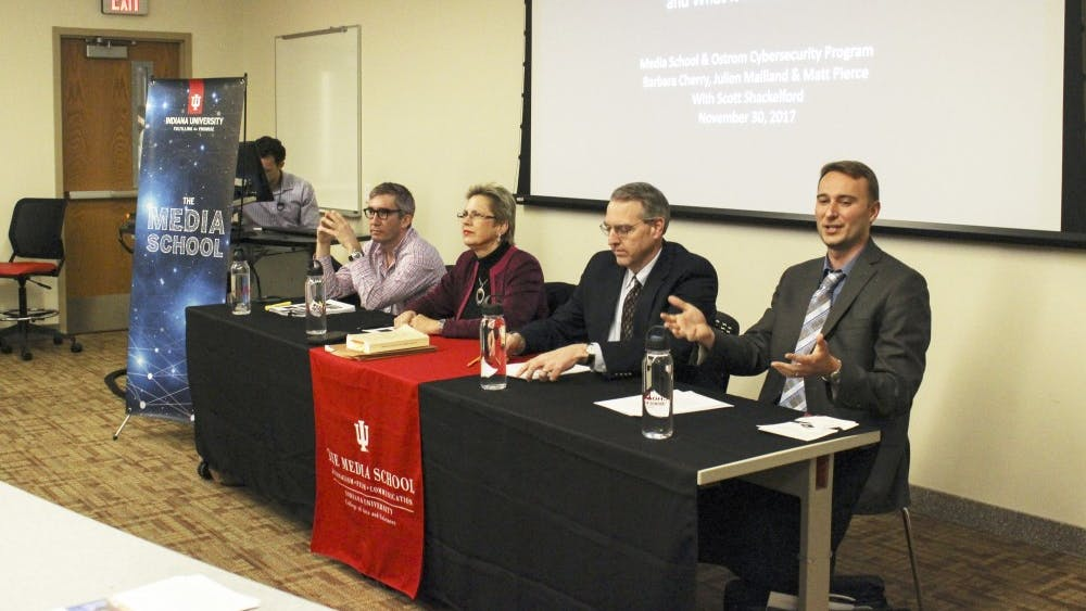 Scott Shackelford introduces the panel on net neutrality with professor Barbara Cherry, assistant professor Julien Mailland and senior lecturer Matt Pierce. The panel was hosted by the Media School and the Ostrom Cybersecurity Program.