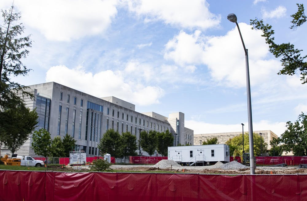 <p>A construction site sits in front of the Global and International Studies building Aug. 11 at North Jordan Avenue and Seventh Street. IU is constructing a new building for the Eskenazi School of Art, Architecture and Design. </p>