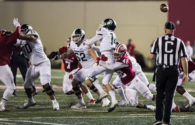 Sophomore defensive back Marcelino Ball tackles Michigan State junior quarterback Brain Lewandowski during the third quarter Sept. 23. The Hoosiers lost 35-21.