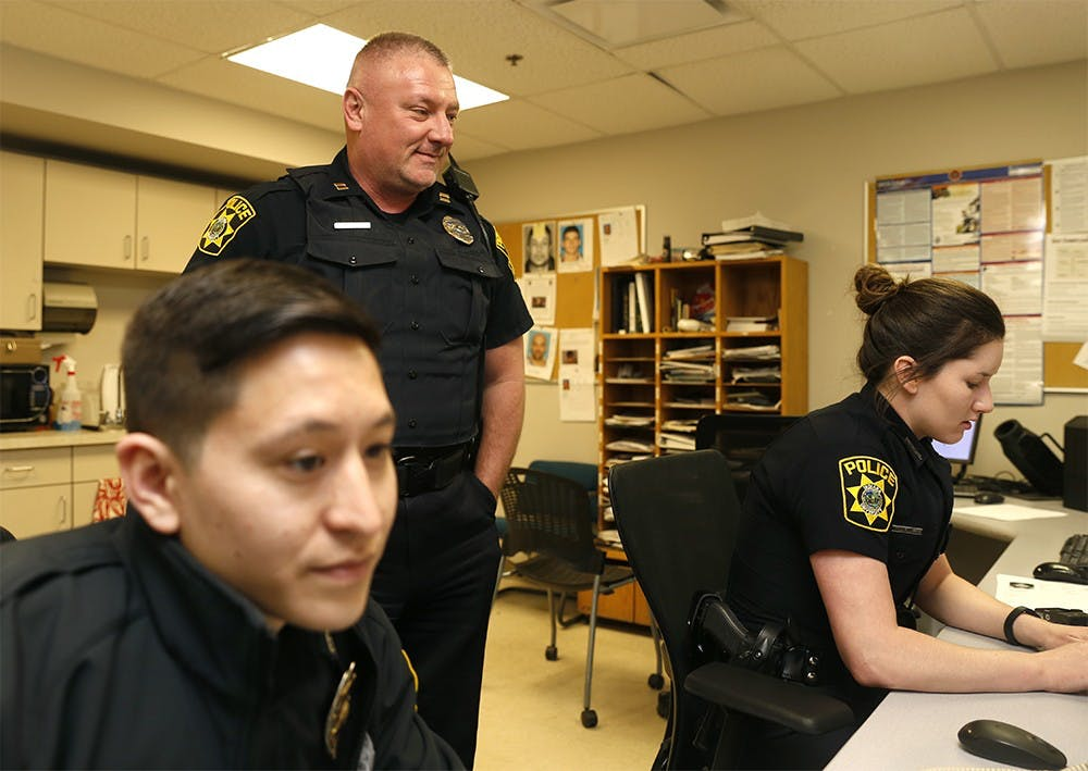 Andy Stephenson, IUPD captain, checks in with officers Joshua Sung, left, and Briana Guy Friday at IUPD station. After almost 20 years on the force, Stephenson said blue lights have only been used four times for legitimate emergencies.