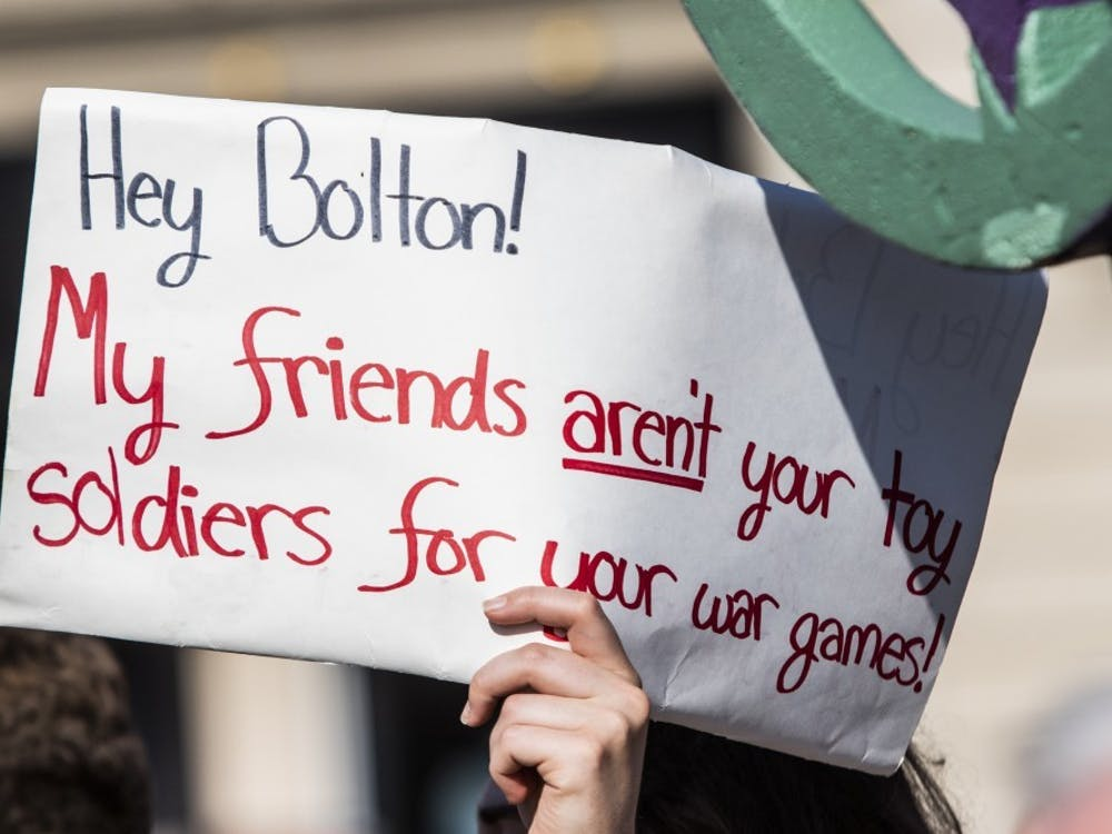 """A sign reads, """"Hey Bolton! My friends aren't your toy soldiers for your war games,""""June 26 in front of the Monroe County Courthouse. The media has been concealing information about Iran, writes opinion columnist Bryce Greene ."""