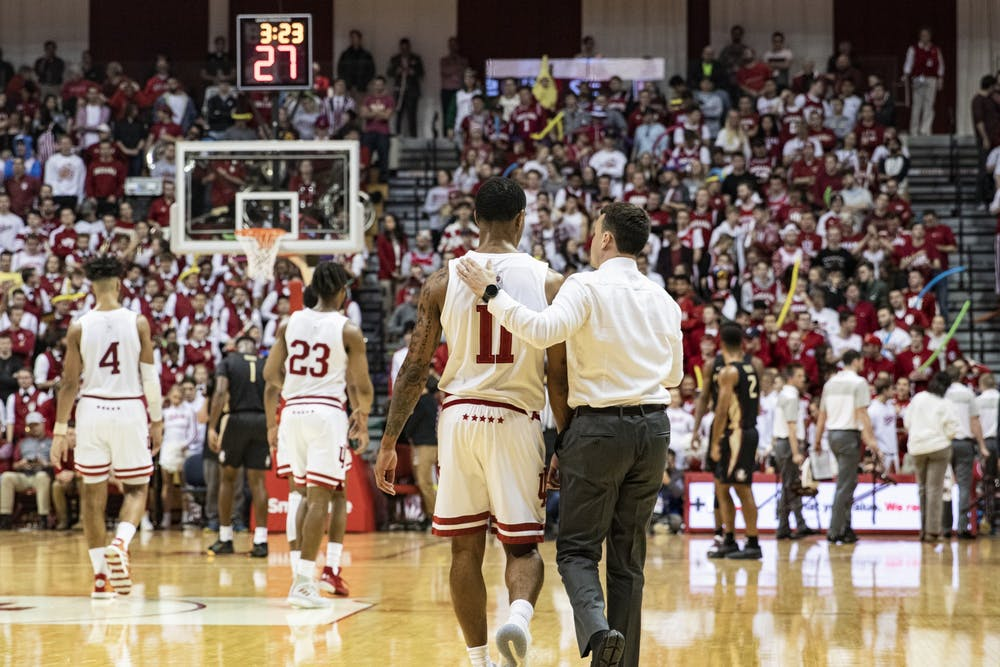 <p>IU men&#x27;s basketball head coach Archie Miller talks to senior guard Devonte Green during a timeout in the second half of the game Dec. 3 in Simon Skjodt Assembly Hall. IU beat Florida State University 80-64.</p>