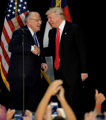 Former New York City mayor Rudy Giuliani, left, welcomes then-Republican presidential candidate Donald Trump on stage during a campaign rally Aug. 18, 2016, at the Charlotte Convention Center in Charlotte, North Carolina. House Speaker Nancy Pelosi signaled her readiness to take stronger action against President Donald Trump over a phone call with Ukraine's president.