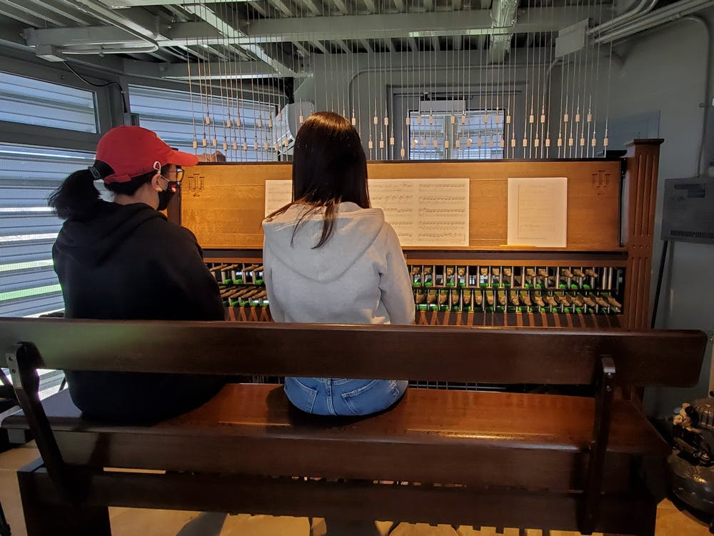 <p>Graduate student Lynnli Wang plays the carillon with Kyounghwa Oh on Saturday in the Arthur R. Metz Bicentennial Grand Carillon. The &quot;Meet Me at the Metz&quot; recital was dedicated to the Stop Asian Hate movement. </p>