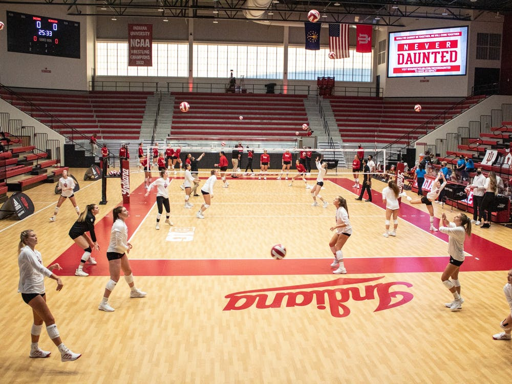 The Hoosiers warmup prior to their match against Nebraska on Jan. 23 at Wilkinson Hall. The team had 27 kills but came up short against the Cornhuskers for its second straight loss.
