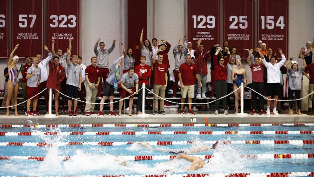 The IU men's and women's swimming and diving teams cheer on freshman Michael Brinegar during his final lap Nov. 17 at Counsilman Billingsley Aquatic Center. Brinegar placed first in the 1650 freestyle, breaking a school record.