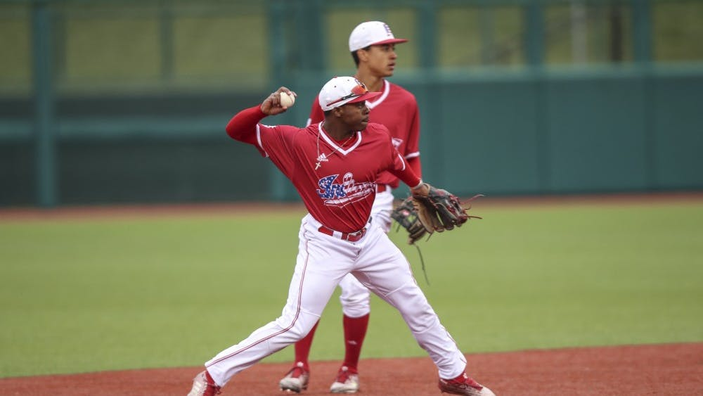 Sophomore Jeremy Houston throws the ball to first for the out during the Hoosiers' game against the Indiana State Sycamores on April 10. IU will face Ohio State this weekend starting Friday.