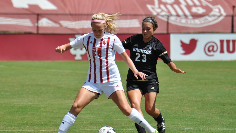 Sophomore defender Caroline Dreher tries to avoid Western Michigan midfielder Tiffany Buckler at Bill Armstrong Stadium on Sunday. IU lost 2-0, giving them an 0-1-1 record after their first weekend of the season.