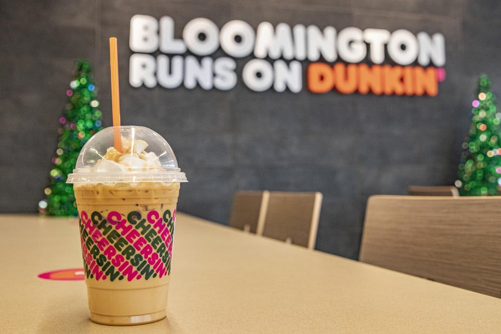 <p>A Caramel Craze iced latte sits on a table Dec. 7 inside a Dunkin' and Baskin Robbins in Bloomington. Dunkin' had its opening day Monday and is located on the corner of Third Street and South College Mall Road.</p>
