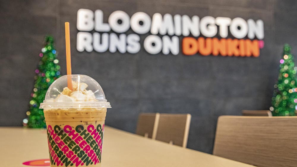 A Caramel Craze iced latte sits on a table Dec. 7 inside a Dunkin' and Baskin Robbins in Bloomington. Dunkin' had its opening day Monday and is located on the corner of Third Street and South College Mall Road.