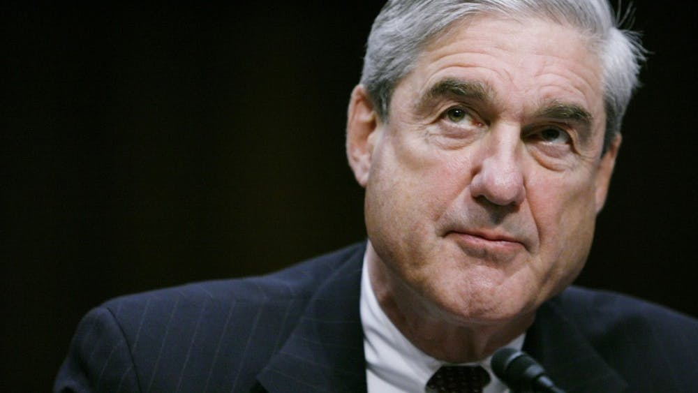 Robert Mueller testifies before a Senate Intelligence Committee hearing in February 2011 in Washington, D.C. The report made by Mueller in his role as special counseldid not conclude that the president committed a crime.