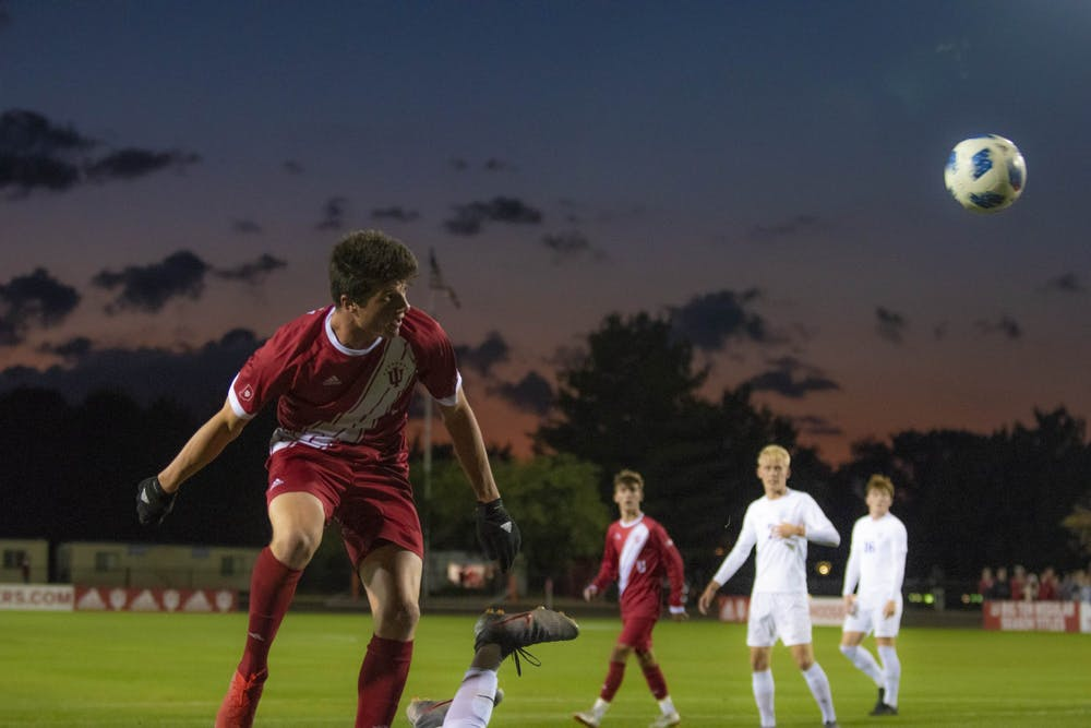 <p>Then-redshirt freshman Daniel Munie heads a ball back towards the University of Evansville's goal Oct. 22, 2019, at Bill Armstrong Stadium in Bloomington. Munie scored Indiana&#x27;s only goal against the University of Akron on Friday.</p>