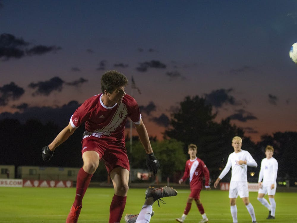 Then-redshirt freshman Daniel Munie heads a ball back towards the University of Evansville's goal Oct. 22, 2019, at Bill Armstrong Stadium in Bloomington. Munie scored Indiana's only goal against the University of Akron on Friday.