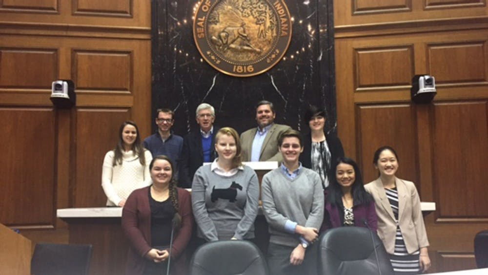 Eight of the high school and college New Voices of Indiana team members meet at the Indiana Statehouse, Wednesday, Dec. 7 to draft legislation for a press freedoms bill. They met with stakeholders who would be interested in the legislation.