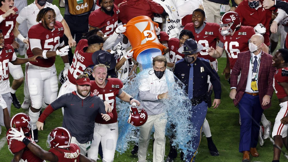 Alabama Crimson Tide players dunk gatorade on head coach Nick Saban in celebration following the College Football Playoff National Championship game at Hard Rock Stadium on Jan. 11 in Miami Gardens, Florida.