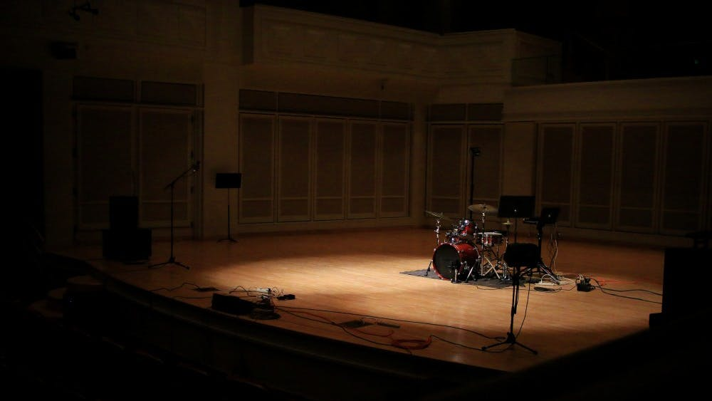 "The Auer Concert Hall stage stays empty during ""Do Not Break Anything,"" written by Daniel Allen. The piece was part of the Computer Music Recital that took place Dec. 2."