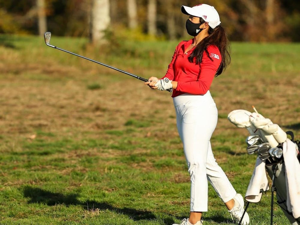 Then-senior Angela Aung swings her golf club April 4, 2021, during the Indiana Spring Challenge at Covered Bridge Golf Club. Indiana women's golf's schedule was released Wednesday.