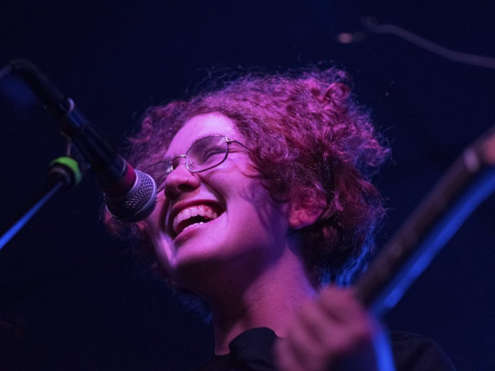 """Cleo Tucker sings to """"Ideal World,"""" a song from Girlpool's 2015 album """"Before The World Was Big,"""" on Thursday night at the Bishop. Tucker, who performs guitar and vocals, sang to a crowded room, """"I thought I found myself today. No one's noticed things are okay."""""""
