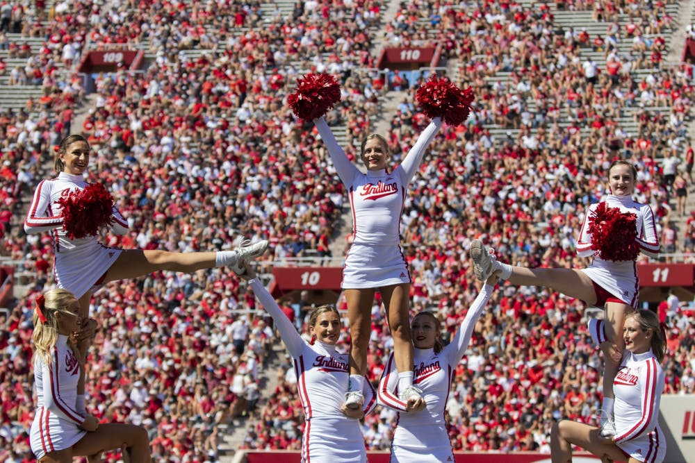 IU cheerleaders stand in formation in the air Sept. 14, 2019, in Memorial Stadium. The IU Crimson Squad cheer team has created weekly challenges on social media that have been reposted by IU's Instagram account.