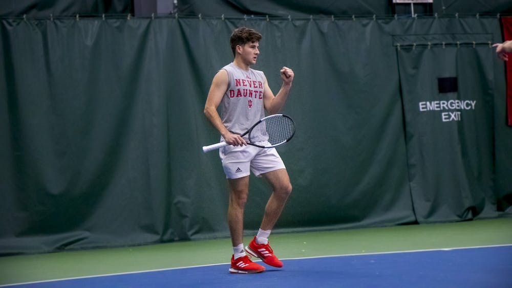 IU senior Zac Brodney celebrates a point against University of Memphis on Jan. 17 at the IU Tennis Center. IU clenched the win in a tough battle against Memphis, 4-3.
