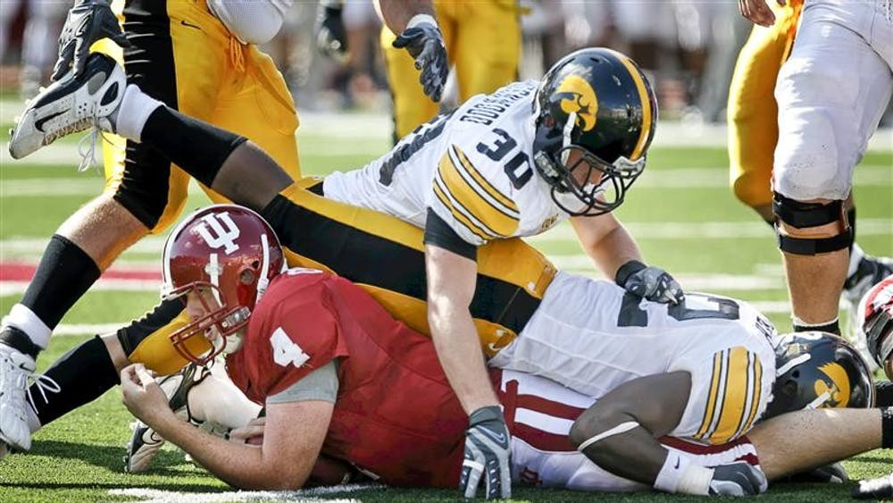 Sophomore quarterback Ben Chappell is tackled at the line of scrimmage during the Hoosiers 45-9 loss to Iowa on Saturday afternoon at Memorial Stadium. The 2-4 Hoosiers suffered its fourth loss in a row.
