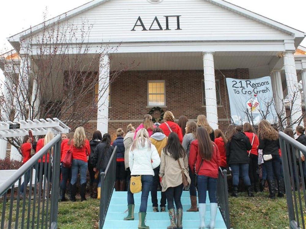 Potential soroity members wait outside Alpha Delta Pi Sunday during the second day of 21 Party, the first official event of women's recruitment. 21 Party allowed women to meet members of each of the 21 Panhellenic Association chapters.