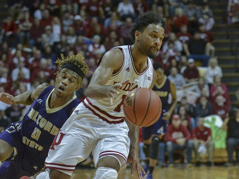 Sophomore guard James Blackmon Jr. trips up his Alcorn State defender as he drives for layup Monday at Assembly Hall. The Hoosiers won 112-70.