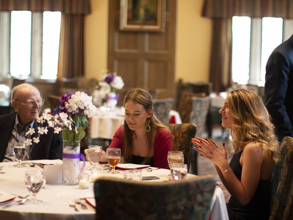Members of the IU law fraternity Phi Alpha Delta talk and eat April 10 in the Tudor Room of the Indiana Memorial Union. The fraternity celebrated its fourth annual fundraiser for Indiana Legal Services.