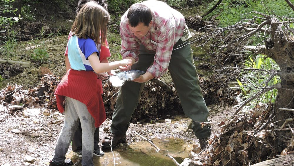 Gibson brings kids from the classroom into nature and encourages them to look and learn from what they find outside to make them more involved with nature.
