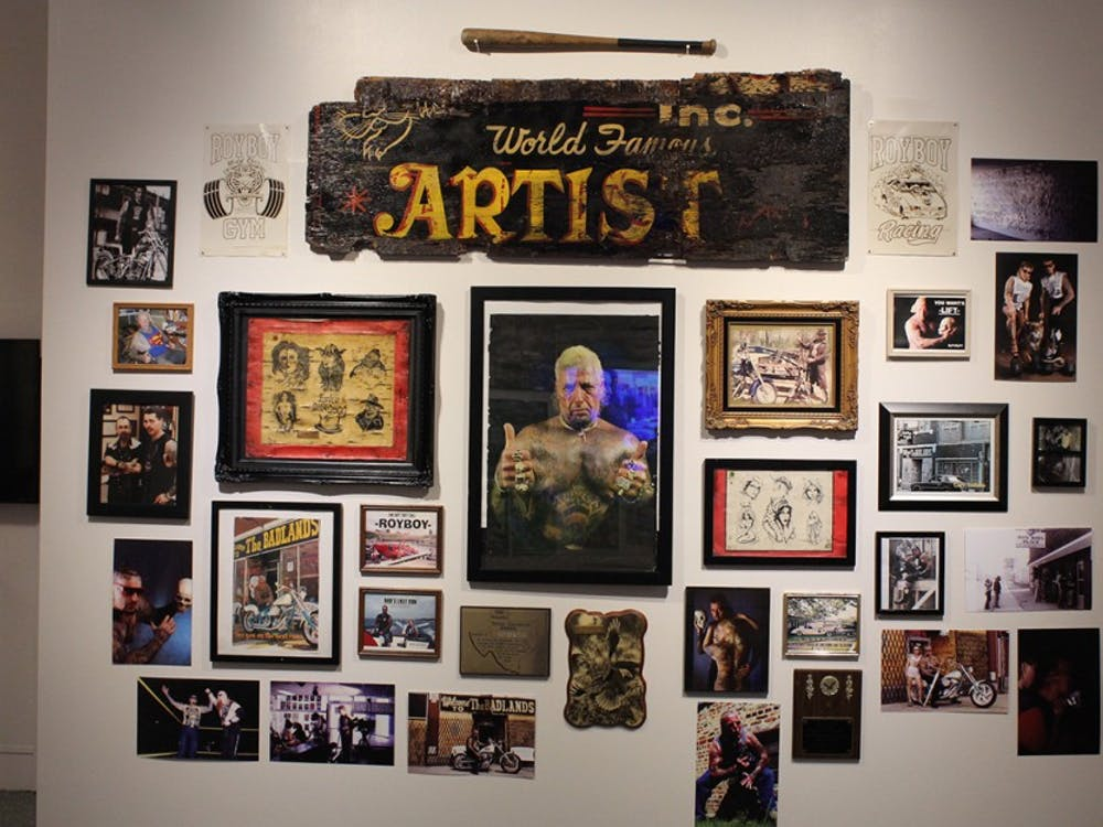 Memorabilia from Roy Boy's tattoo shop hangs on a wall at the Grunwald Gallery. The pieces are part of the gallery's newest exhibit, which focuses on the history and legacy of Indiana tattoos and tattoo artists.