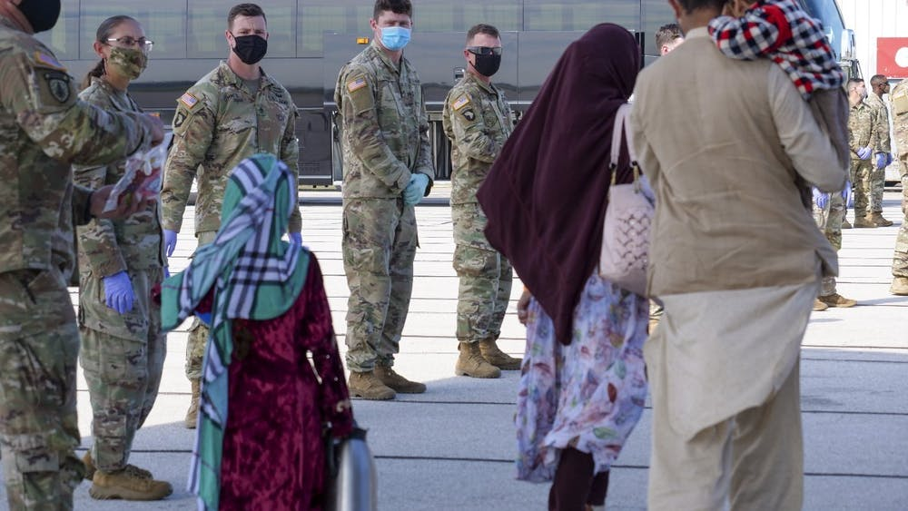 Afghan evacuees arrive in Indianapolis Thursday, Sept. 2, 2021, as 1st Cavalry Division soldiers watch. Camp Atterbury has served as a temporary shelter for Afghan evacuees since the U.S. withdrew its forces from Afghanistan on Aug. 30.